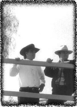 Leland and his brother as railroad men.